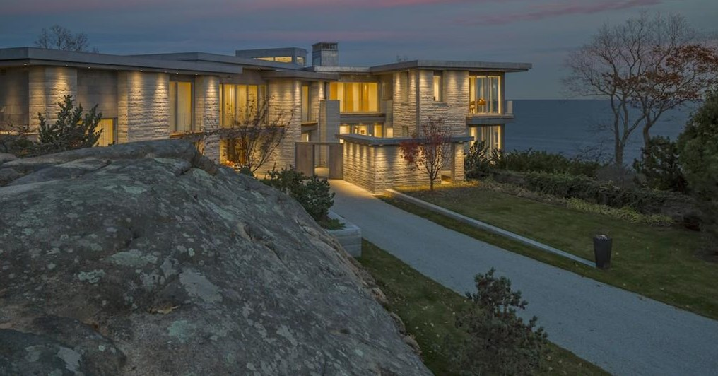 Spectacular oceanside modern beach house in Manchester-By-The-Sea Massachusetts. #modern #beach #coastal #home #oceanside #views #stone #glass #exterior at sunset