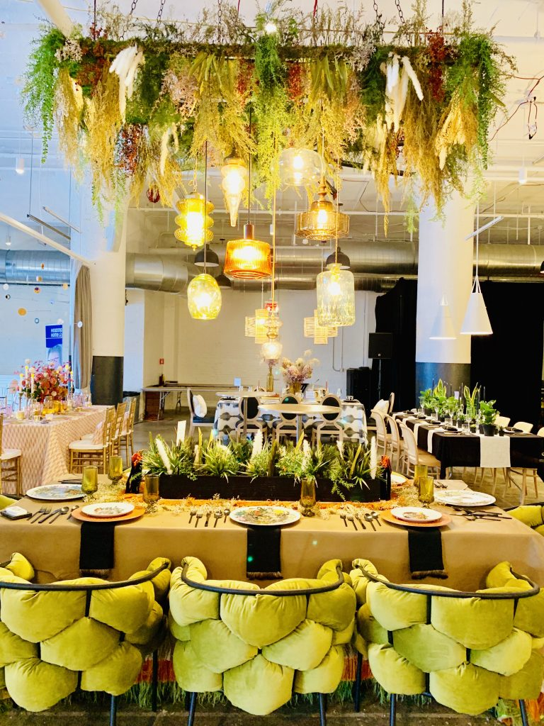Designer Tina Anastasia Heading Home to Dinner 2019 beautiful tablescapes chairs and chandelier