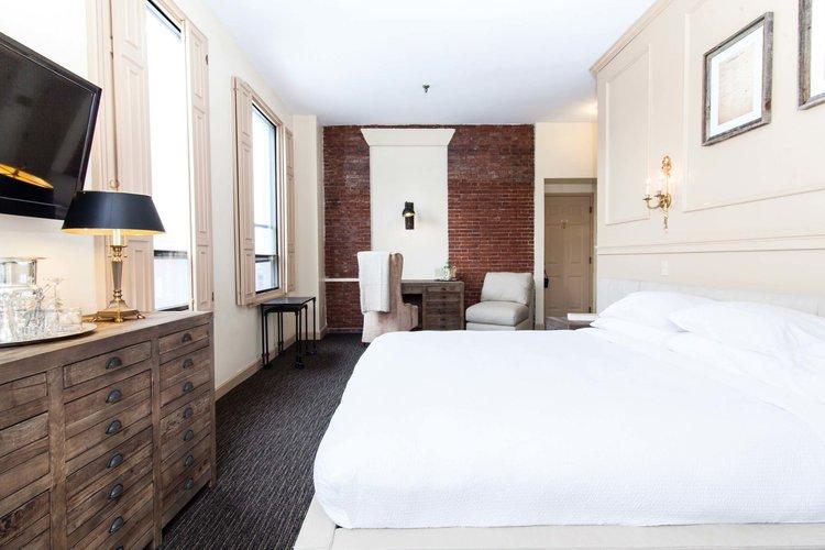 Garrison Inn Room corner king white duvet guest bedroom