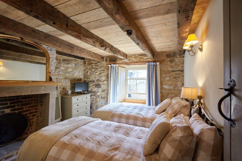 Tudor stone bastle Northumberland England Photo by David Webb Bastle twin bedroom cottage guest bedroom